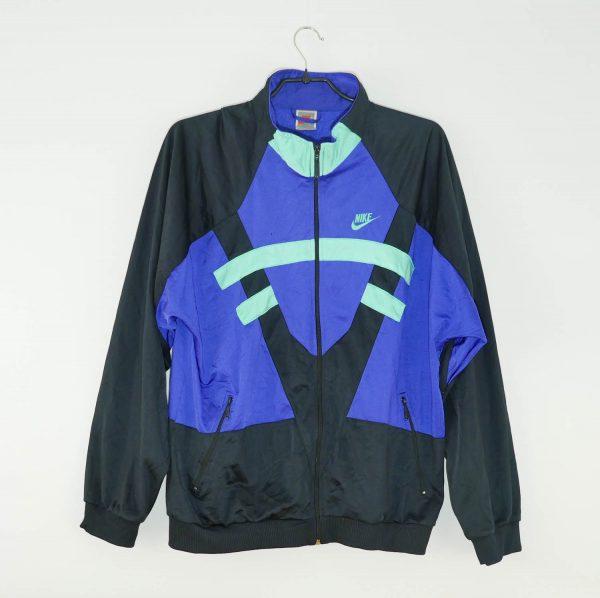 Veste survêtement Nike Très bon état Taille fabricant: L Taille conseillée: L L=66 cm h=61 cm